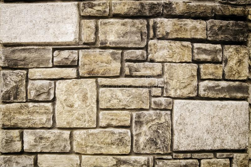 Background image of a stone fence of different sizes stock images