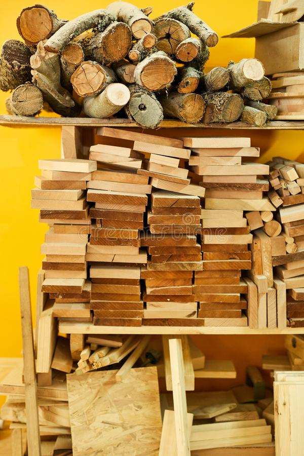 Wooden Materials in Joinery. Background image of wood stand with branches and boards in joinery shop, copy space stock photo