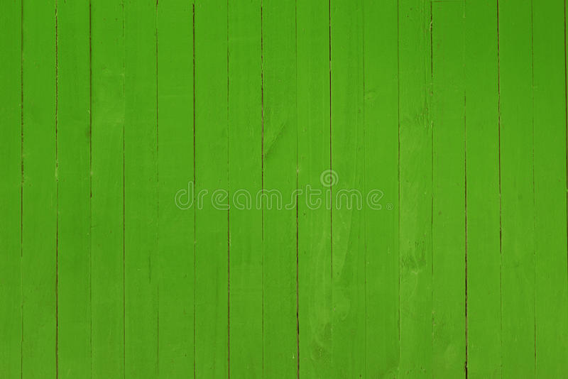 Background image of a wooden wall painted in bright red color stock photo