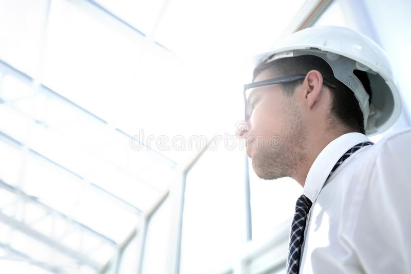 Background image. young architect in an empty office stock images