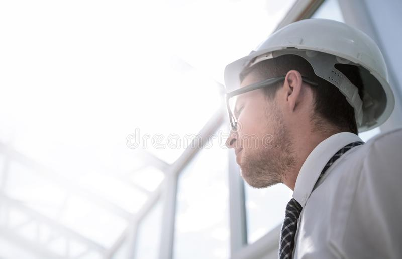 Background image. young architect in an empty office stock photo