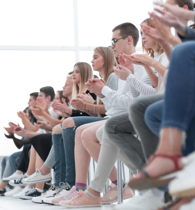 Background image of young people applauding in the conference room stock images