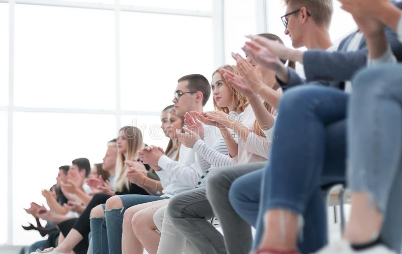 Background image of young people applauding in the conference room royalty free stock image