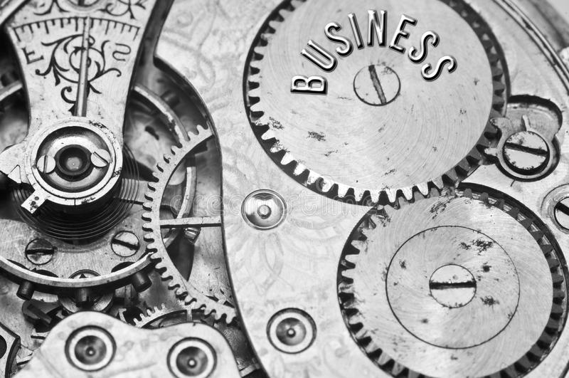 Background with the inscription BUSINESS. Black white background. With metal cogwheels clockwork. Macro. Conceptual photo for your successful business design royalty free stock photos