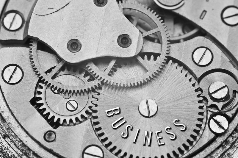 Background with the inscription BUSINESS. Black white background. With metal cogwheels clockwork. Macro. Conceptual photo for your successful business design stock photo