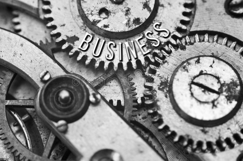 Background with the inscription BUSINESS. Black white background. With metal cogwheels clockwork. Macro. Conceptual photo for your successful business design royalty free stock images