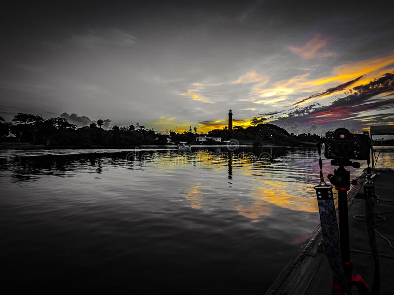 Daybreak over the Lighthouse and in the Viewfinder. Background of the Jupiter, Florida, lighthouse as the predawn light begins to light the sky and the royalty free stock image