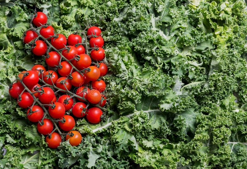 Background with kale and cherry tomatoes on it royalty free stock images