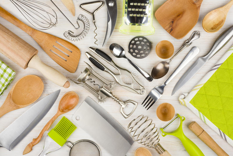 Background of kitchen utensils on wooden kitchen table stock image