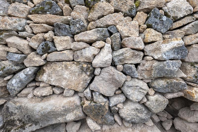 Background of large and small hand-stacked stones without cement stock photo