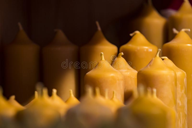 Background of large wax candles. Close up stock photo