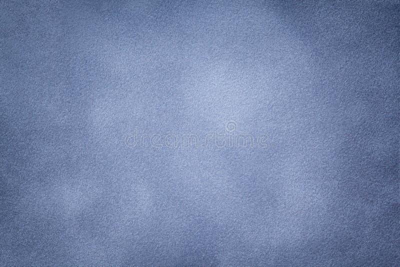Background of light blue suede fabric closeup. Velvet matt texture of steel nubuck textile stock photography