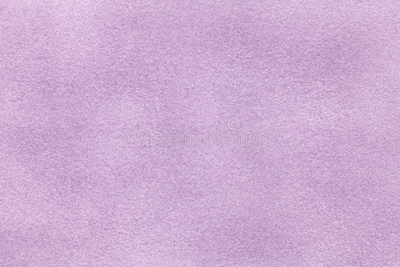 Background of light violet suede fabric closeup. Velvet matt texture of lilac nubuck textile.  stock image
