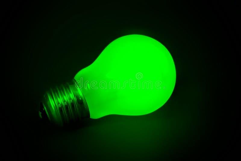 Background with lit lightbulb stock photo