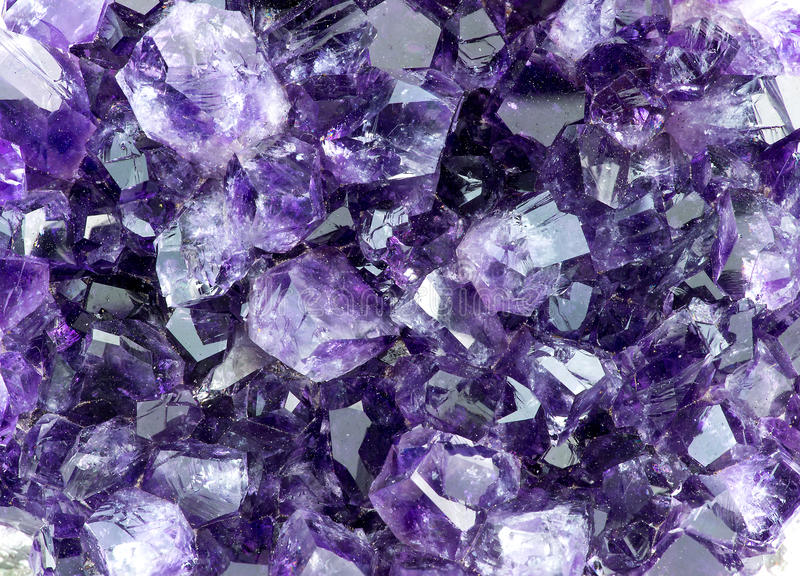 Background macro texture of purple amethyst. Crystals royalty free stock image