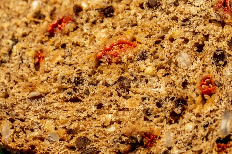 Background macro whole grain bread with seeds, walnut, goji berry. healthy food concept. space for text. top view royalty free stock photos