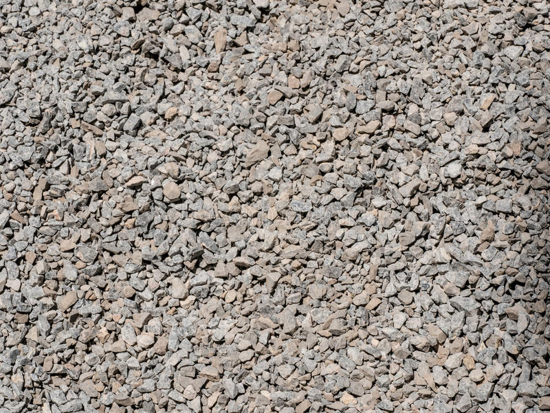 Background made of close-up photo of crushed stone. Abstract grey and beige gravel stone background crushed gray stones and granite pieces texture large detailed stock image