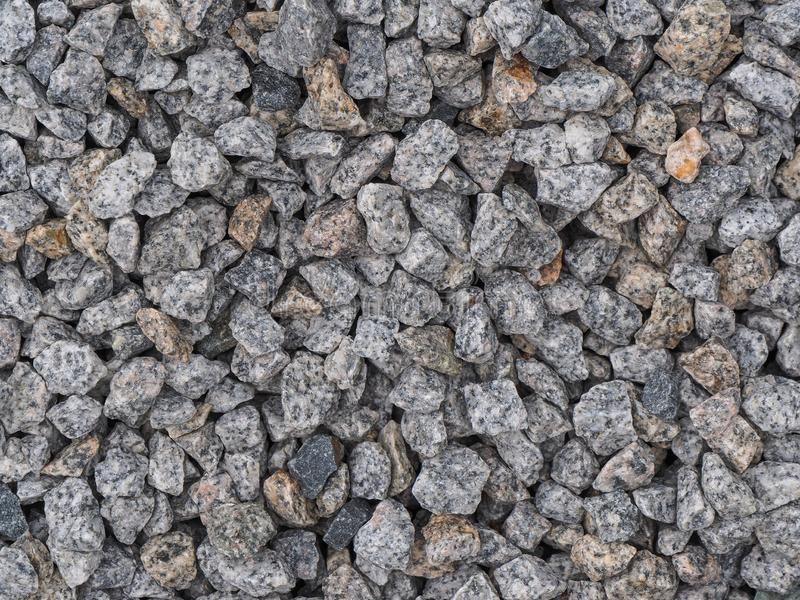 background made of a closeup of a pile of crushed stone stock photo