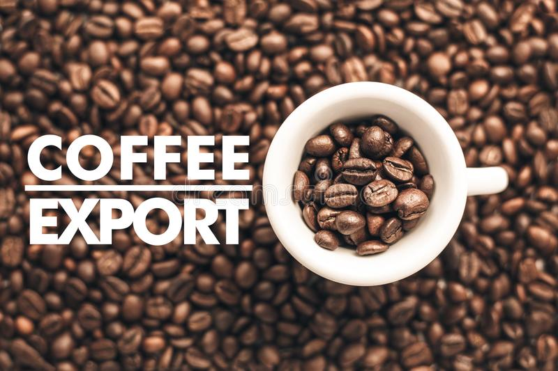 Background made of coffee beans with message `Coffee Export`. Coffee business advertisement and background stock photography