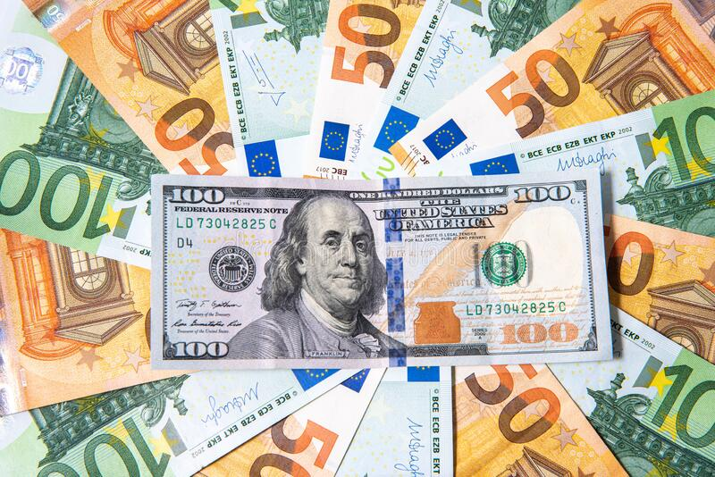 Background made of euro banknotes and dollar banknote. Background made of euro banknotes and hundred dollar banknote above stock images
