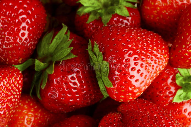 Background made from many red juicy fresh strawberries royalty free stock photo
