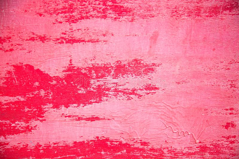 The background is made of old plywood, painted in bright red in some places the paint peeled off and smudges. royalty free stock photography