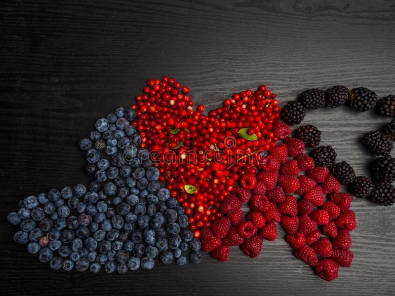 Background made of raspberry, blueberry, cranberry in heart shape Top view. High resolution product, rich in vitamin and stock image