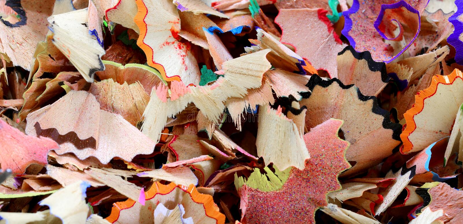 background of many colored pencils shavings royalty free stock photography