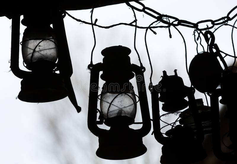 Background of many lit storm lanterns or hurricane lamps.  royalty free stock photo