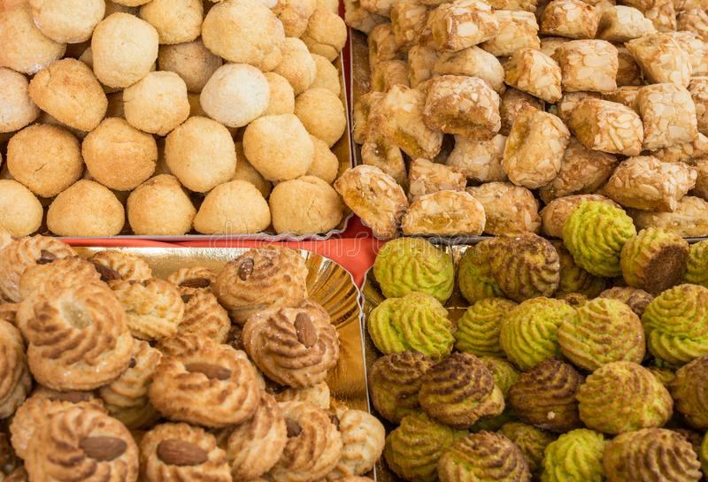 Background of many pastries made with sweet almonds a typical Italian culinary specialty with candied fruit and pistachios.  stock images