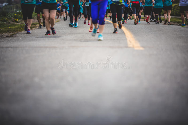 Background of Marathoners Feet with Copy Space for Text. CARLETON, CANADA - June 4, 2017. During the 5th Marathon of Carleton in Quebec, Canada. Background of stock photo
