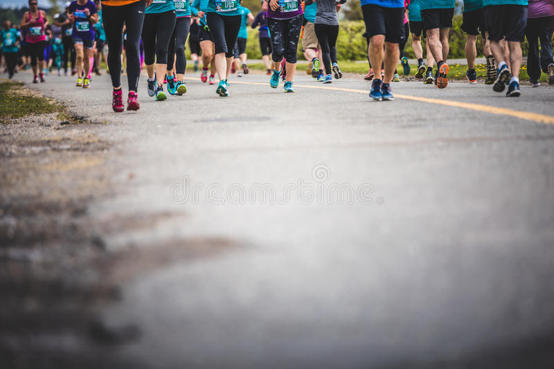 Background of Marathoners Feet with Copy Space for Text. CARLETON, CANADA - June 4, 2017. During the 5th Marathon of Carleton in Quebec, Canada. Background of royalty free stock photo