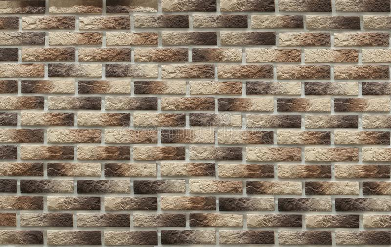 Background of masonry brown clinker bricks on the wall, which are used in the repair of premises. Background of masonry colored clinker bricks on the wall, which royalty free stock images