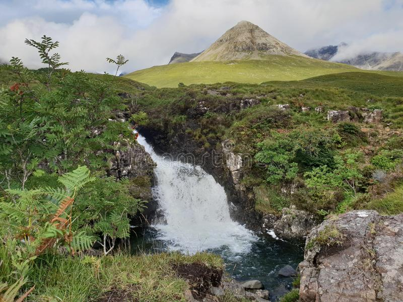 Background mauntan with waterfall. Background mountain with waterfall and tropical nature. forest nature reserve park isle of skye scotland royalty free stock images