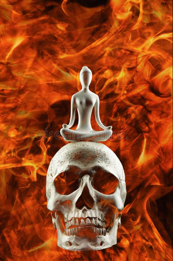 Background of meditation on human skull on fire in concept of meditation to fight anger.  stock photography