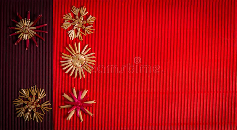 Background for Merry Christmas greeting card with straw decoration on textured paper royalty free stock images