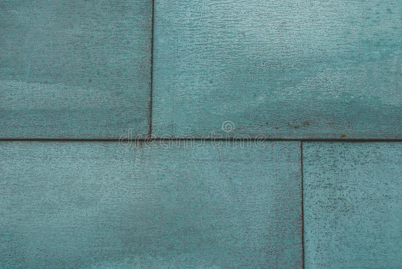 Metal panels painted in turquoise stock image