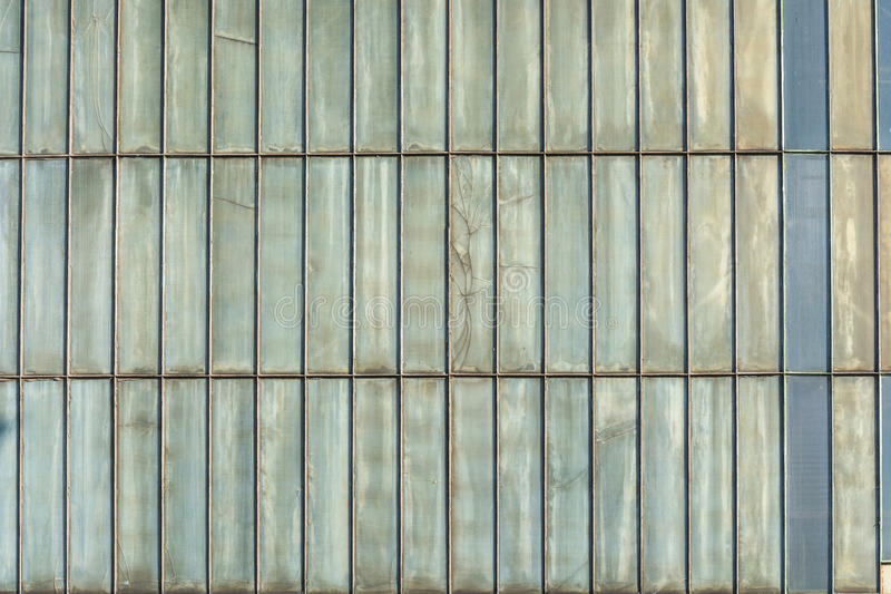 Background metal wall. Silver-colored metal wall corrugated sheet metal background stock photography
