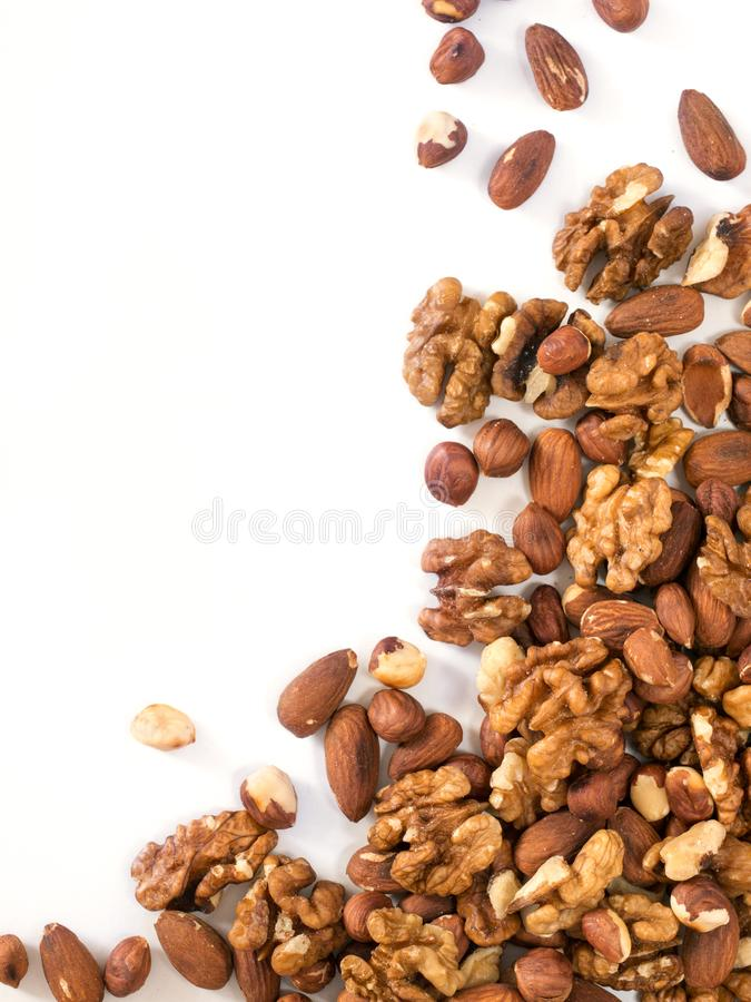 Background of mixed nuts with copy space vertical stock image