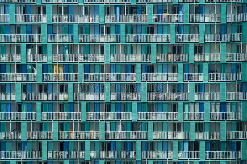 Background of a modern architecture texture of a skyscraper wall with balconies and windows stock photos