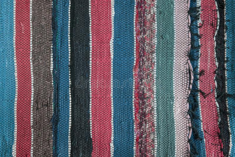 Background of multi-colored homespun rug royalty free stock photo