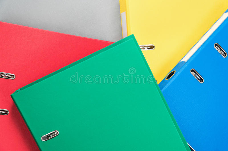 Background of multi-colored office folders stock image