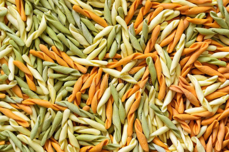 Background from multi-colored pasta. Traditional Italian cuisine. royalty free stock images