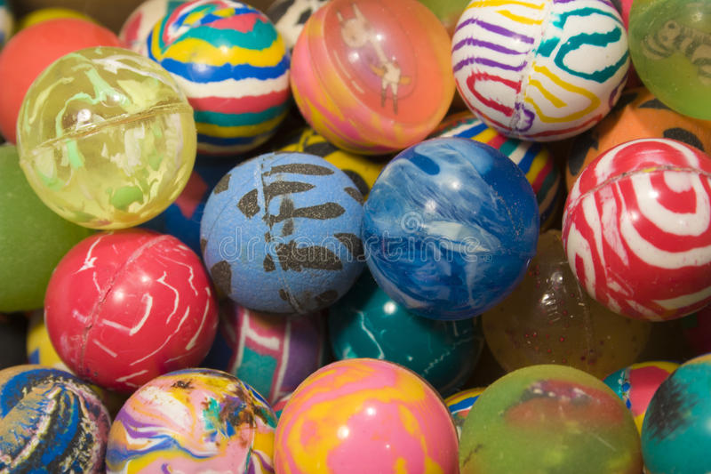 Background from multi-colored rubber balls from the vending machine supermarket stock image