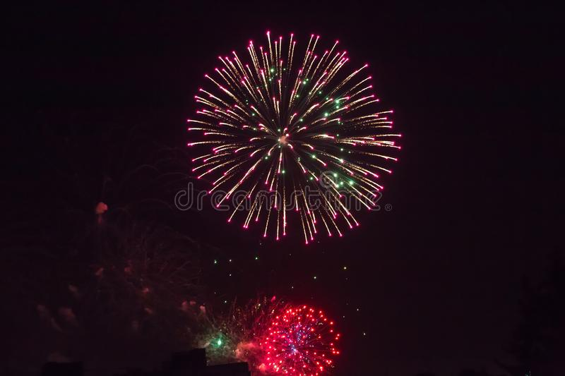 Background of multi-colored salute and fireworks closeup on a black background stock images