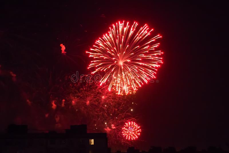 Background of multi-colored salute and fireworks closeup on a black background stock photography