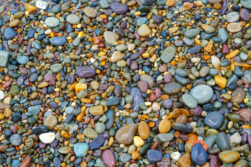 Background from multi-colored sea stones royalty free stock images