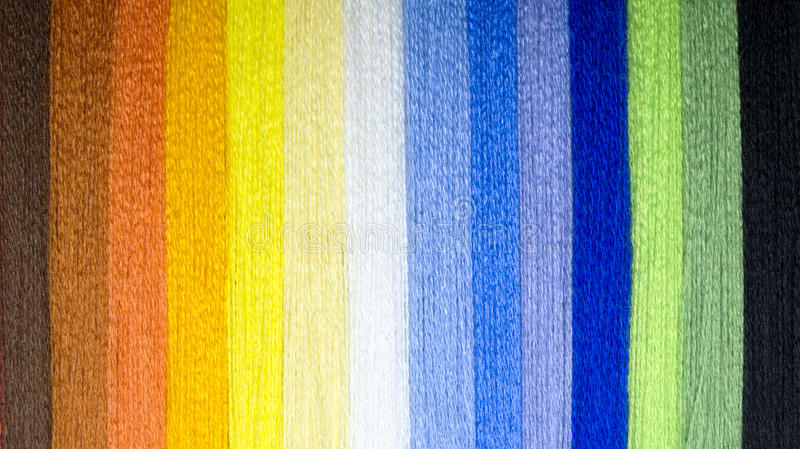 Background from multi-colored threads. A rainbow of thread. Colored strips of thread. The background image for design royalty free stock images