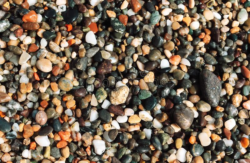 Background of multicolored wet sea pebbles. stock photo