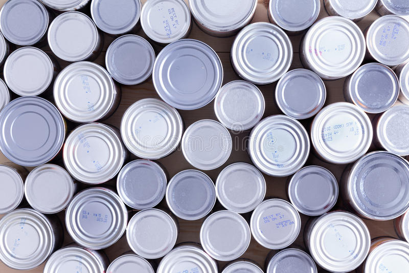 Background of multiple sealed food cans royalty free stock images